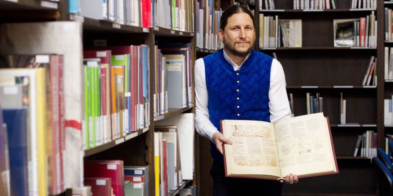 Ivan Foletti, head of the Centre for Early Medieval Studies with one of the gifted books.
