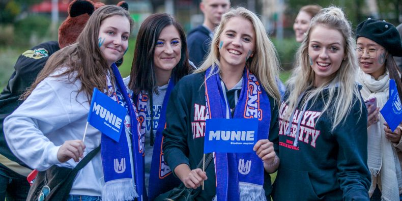 Before the hockey game there was a parade in the city center where people were all dressed up with their Masaryk University gear on and their faces painted.