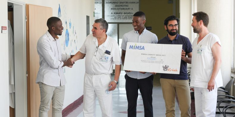 Medical students give the cheque to Jaroslav Štěrba, the head of the Clinic of Pediatric Oncology.