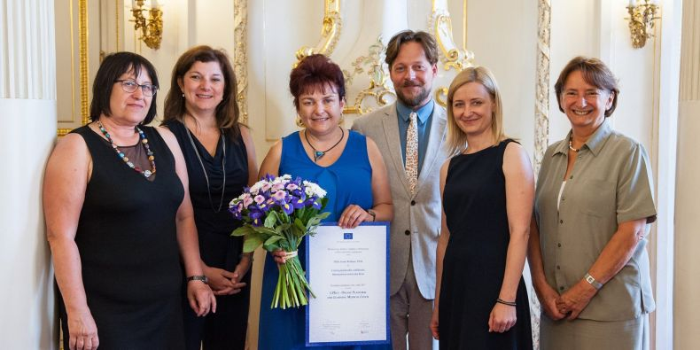 The main person behind the project Ivana Rešková (in the middle) receiving the European Language Label 2017.